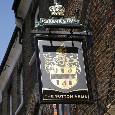 London, UK - April 01, 2012: English pub sign. Public house, known as pub, for drinking and socializing, is the focal point of the community. Pub business, now about 53,500 pubs in the UK, has been declining every year.