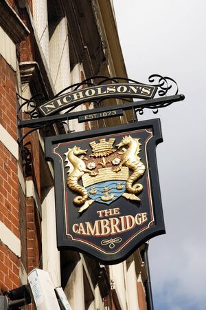 London, UK - April 15, 2012: English pub sign. Public house, known as pub, for drinking and socializing, is the focal point of the community. Pub business, now about 53,500 pubs in the UK, has been declining every year.