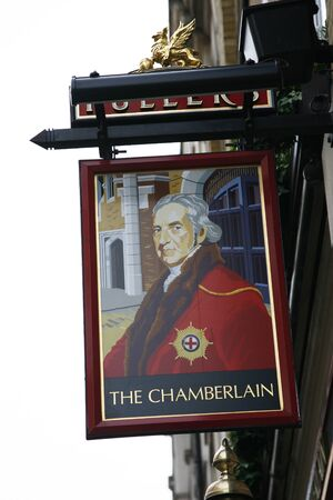 London, UK - April 30, 2012: English pub sign. Public house, known as pub, for drinking and socializing, is the focal point of the community. Pub business, now about 53,500 pubs in the UK, has been declining every year.