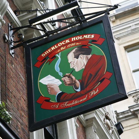 holmes: London, UK - May 06, 2012: English pub sign. Public house, known as pub, for drinking and socializing, is the focal point of the community. Pub business, now about 53,500 pubs in the UK, has been declining every year.