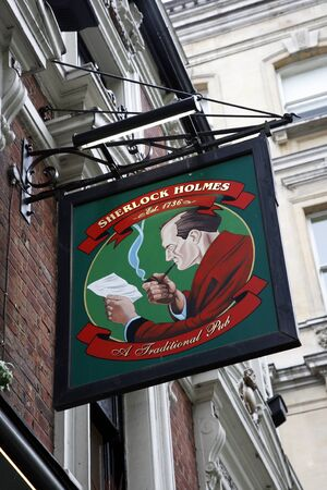 London, UK - May 06, 2012: English pub sign. Public house, known as pub, for drinking and socializing, is the focal point of the community. Pub business, now about 53,500 pubs in the UK, has been declining every year.