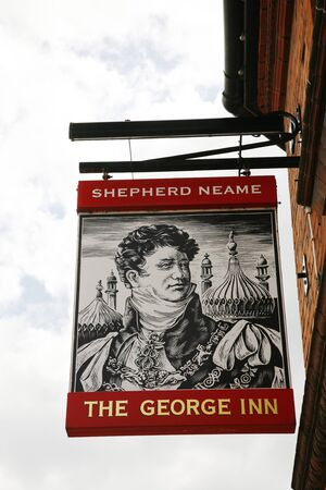 London, UK - May 16, 2012: English pub sign. Public house, known as pub, for drinking and socializing, is the focal point of the community. Pub business, now about 53,500 pubs in the UK, has been declining every year.  Stock Photo - 14139150