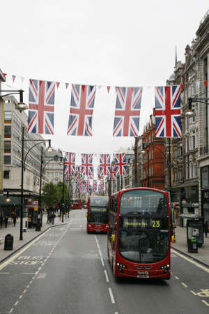 London, UK - May 5, 2012: Oxford Street in London, decorated with union jack flags to celebrate the Queens diamond Jubilee. The main celebration events was held from June 2 to June 5, 2012.