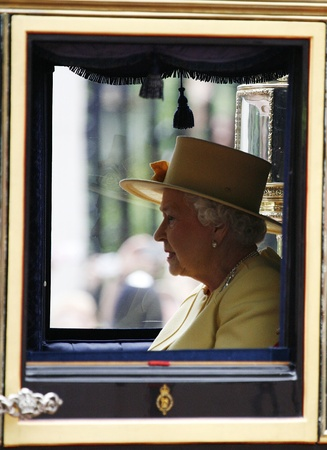 London, UK - June 16, 2012: Queen Elizabeth II and Prince Philip seat on the Royal Coach at Queens Birthday Parade. Queens Birthday Parade take place to Celebrate Queens Official Birthday in every June in London.