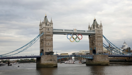 London, UK - July 19, 2012: 2012 London Olympic Rings on Tower Bridge. The rings were originally lowered into place on June 27th 2012, however, unveiled on 26th, to mark one month before the start of the London 2012 Olympic games.