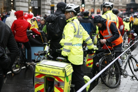 London, UK - April 28, 2012: St John Ambulance aiders, bicycles allow to move more quickly through crowds with medical equipment, are ready to help patients at THE BIG RIDE, London Cycling Campaign.