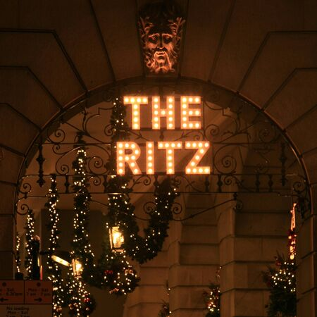 '5 december': London, UK -  December 21, 2010: The Ritz hotel, 5 star, located in Piccadilly, neoclassical style, built by Charles Mewes, opened on 1906, sign with Christmas decoration at night.