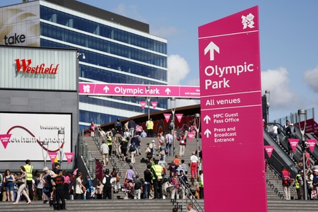 stratford: London, UK - July 30, 2012: Entrance of London Olympic Park in Stratford, East London. Crowds of spectators walking into the Olympic Park.