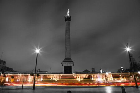 Nelsons Column stands in Trafalgar Square to commemorate Admiral Nelson  photo