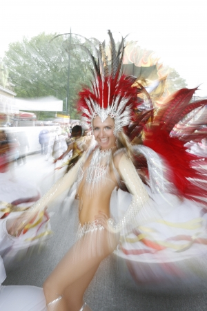 London, UK - August 27, 2012: Performers take part in the second day of Notting Hill Carnival, largest in Europe. Carnival takes place over two days in every August.