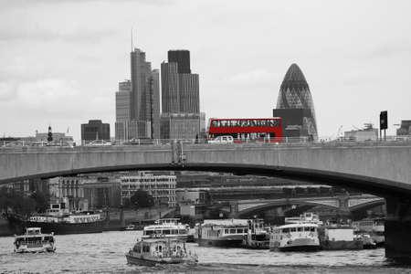 London skyline, include Waterloo Bridge, Red Double Decker Bus, seen from Victoria Embankment