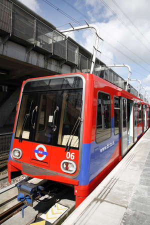 London, UK - April 22, 2012: London DLR, Docklands Light Railway, is automated metro system opened in 1987 serving Docklands area, carrying about 60 million passengers a year, of London.   Stock Photo - 15486194