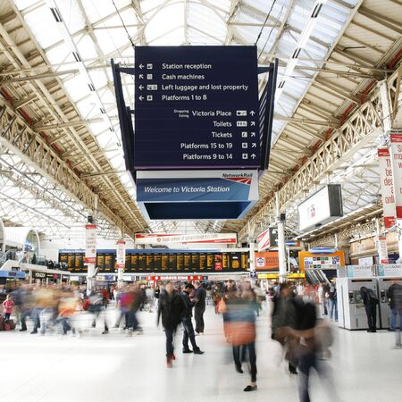 entries: London, UK - April 30, 2012: Inside view of Victoria Station, located in Belgravia, since 1860, second busiest railway terminus after Waterloo in UK, with over 73 million passenger entries and exits between April 2010 and March 2011.