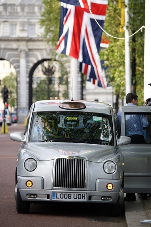 London, UK - June 13, 2012: London Taxi, also called hackney carriage, black cab. Traditionally Taxi cabs are all black in London but now produced in various colors.  Stock Photo - 15547570