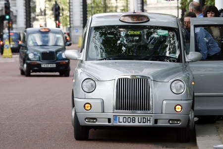hackney carriage: London, UK - June 13, 2012: London Taxi, also called hackney carriage, black cab. Traditionally Taxi cabs are all black in London but now produced in various colors.