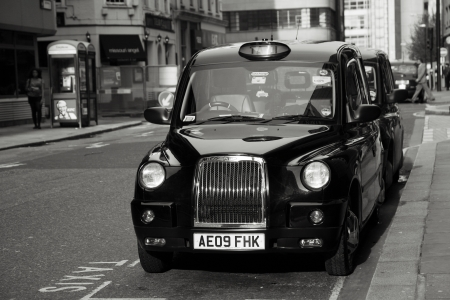 London, UK - April 30, 2012: TX4, London Taxi, also called hackney carriage, black cab. Traditionally Taxi cabs are all black in London but now produced in various colors.