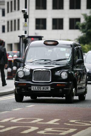 hackney carriage: London, UK - June 14, 2012: TX1, London Taxi, also called hackney carriage, black cab. Traditionally Taxi cabs are all black in London but now produced in various colors.