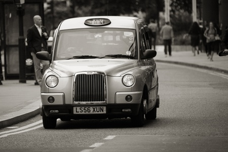 London, UK - June 14, 2012: TX4, London Taxi, also called hackney carriage, black cab. Traditionally Taxi cabs are all black in London but now produced in various colors.
