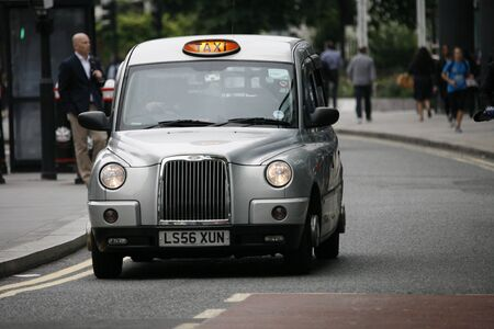 hackney carriage: London, UK - June 14, 2012: London Taxi, also called hackney carriage, black cab. Traditionally Taxi cabs are all black in London but now produced in various colors.  Editorial