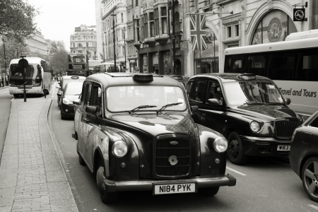 London, UK - May 6, 2012: FX4, London Taxi, also called hackney carriage, black cab. Traditionally Taxi cabs are all black in London but now produced in various colors.