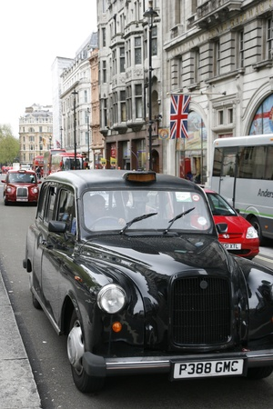 hackney carriage: London, UK - May 6, 2012: FX4, London Taxi, also called hackney carriage, black cab. Traditionally Taxi cabs are all black in London but now produced in various colors.