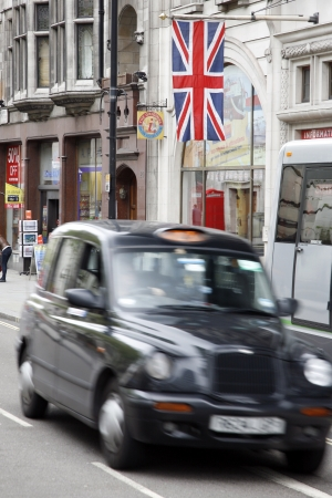 hackney carriage: London, UK - May 6, 2012: TX1, London Taxi, also called hackney carriage, black cab. Traditionally Taxi cabs are all black in London but now produced in various colors.