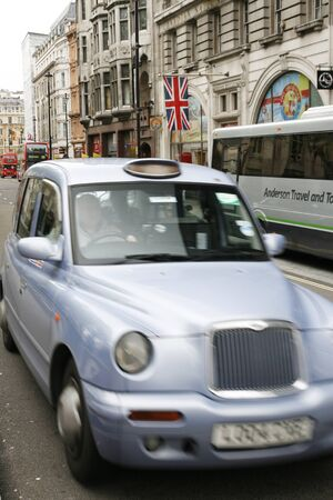 hackney carriage: London, UK - May 6, 2012: London Taxi, also called hackney carriage, black cab. Traditionally Taxi cabs are all black in London but now produced in various colors.