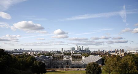 London Skyline seen from Greenwich Park. Overlooking Canary Wharf with Maritime Museum.   photo