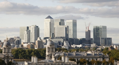 greenwich: London Skyline seen from Greenwich Park. Overlooking Canary Wharf with Maritime Museum.   Stock Photo