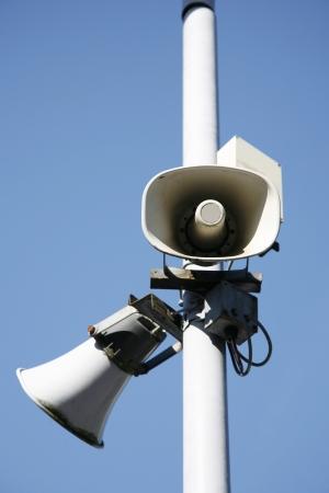 amplification: Close-up loudspeaker on blue sky background