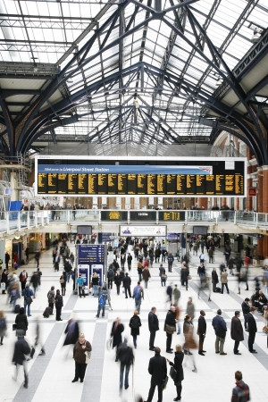 terminus: London, UK - December 12, 2011:  Inside view of Liverpool Street Station, located in City of London, since 1874, third busiest railway terminus after Waterloo and Victoria in UK, served over 55 million passenger between April 2010 and March 2011.