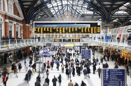 London, UK - December 12, 2011:  Inside view of Liverpool Street Station, located in City of London, since 1874, third busiest railway terminus after Waterloo and Victoria in UK, served over 55 million passenger between April 2010 and March 2011.
