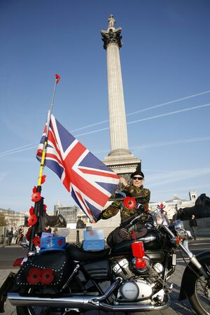 London, UK - November 13, 2011:  War veteran collecting for the annual poppy appeal on behalf of the ROYAL BRITISH LEGION in Trafalgar Square on Remembrance Day, Poppy Day or Armistice Day, 11th every Nov, to remember armed forces who have died since Firs