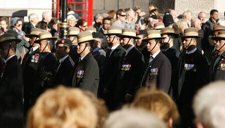 remembrance day poppy: London, UK - November 13, 2011:  People, Gurkha, take part in Remembrance Day, Poppy Day or Armistice Day,  11 every Nov, observed by Commonwealth of Nations, to remember armed forces who have died since First World War, Parade.