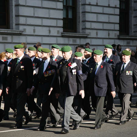 London, UK - November 13, 2011:  People take part in Remembrance Day, Poppy Day or Armistice Day,  11 every Nov, observed by Commonwealth of Nations, to remember armed forces who have died since First World War, Parade.