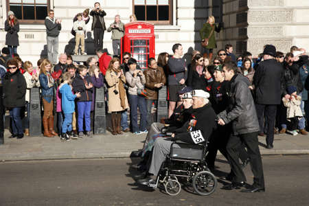 London, UK - November 11, 2012: People take part in Remembrance Day, Poppy Day or Armistice Day, 11 every Nov, observed by Commonwealth of Nations, to remember armed forces who have died since First World War.