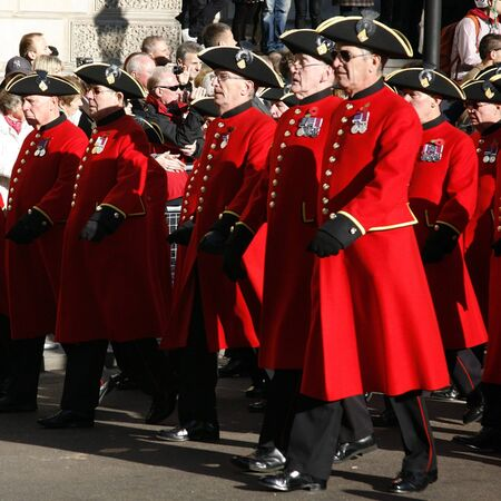 remembrance day poppy: London, UK - November 11, 2012: Members of the Chelsea Pensioners take part in Remembrance Day, Poppy Day or Armistice Day, 11 every Nov, observed by Commonwealth of Nations, to remember armed forces who have died since First World War.