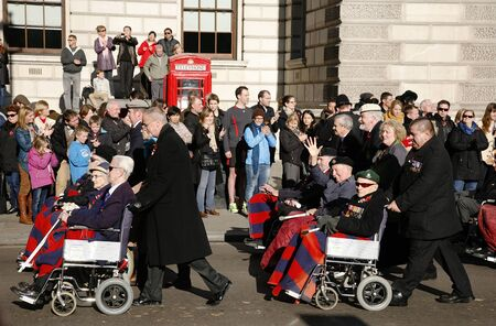 armistice: London, UK - November 11, 2012: People take part in Remembrance Day, Poppy Day or Armistice Day, 11 every Nov, observed by Commonwealth of Nations, to remember armed forces who have died since First World War.