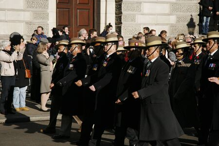 armistice: London, UK - November 11, 2012: People, Gurkha, take part in Remembrance Day, Poppy Day or Armistice Day, 11 every Nov, observed by Commonwealth of Nations, to remember armed forces who have died since First World War.   Editorial