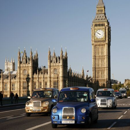 hackney carriage: London, UK - October 27, 2012: London Taxis, also called hackney carriage, black cab, Big Ben in the back ground. Traditionally Taxi cabs are all black in London but now produced in various colors.