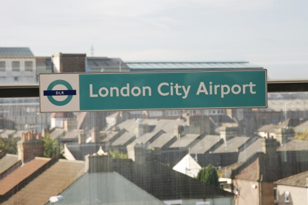 newham: London, UK - October 13, 2012: DLR Station Sign, London City Airport, located in Borough of Newham, owned by GIP, serve about 3 million passengers a year, fifth busiest airport London area.  Editorial