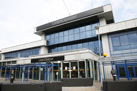 newham: London, UK - October 13, 2012: The terminal buildings of London City Airport, located in Borough of Newham, owned by GIP, serve about 3 million passengers a year, fifth busiest airport London area.