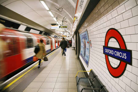 red tube: London, UK - November 11, 2012: Inside view of London Underground, Oxford Circus, oldest underground railway in the world, covering 402 km of tracks,