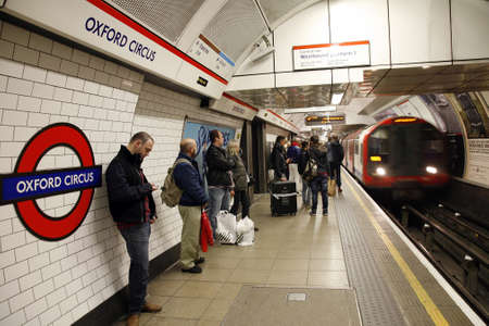 London, UK - November 11, 2012: Inside view of London Underground, Oxford Circus, oldest underground railway in the world, covering 402 km of tracks,