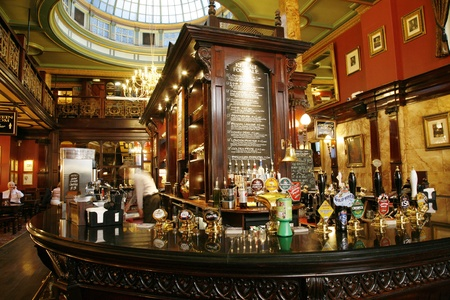 London, UK - July 30, 2012: Inside view of a public house, known as pub, for drinking and socializing, is the focal point of the community, Pub business, now about 53,500 pubs in the UK, has been declining every year.