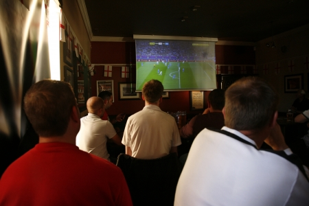 London, UK - June 24, 2012: Inside view of a public house, known as pub, for drinking and socializing, is the focal point of the community, Pub business, now about 53,500 pubs in the UK, has been declining every year.