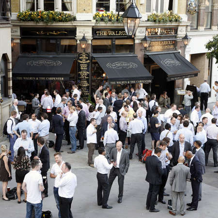 London, UK - July 26, 2012: Outside view of a public house, known as pub, for drinking and socializing, is the focal point of the community, Pub business, now about 53,500 pubs in the UK, has been declining every year.