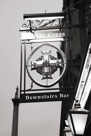 London, UK - January 25, 2011: English pub sign. Public house, known as pub, for drinking and socializing, is the focal point of the community. Pub business, now about 53,500 pubs in the UK, has been declining every year.