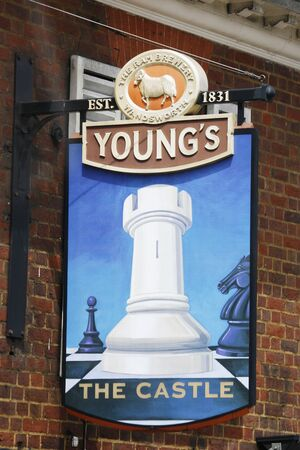 focal point: London, UK - June 14, 2012: English pub sign. Public house, known as pub, for drinking and socializing, is the focal point of the community. Pub business, now about 53,500 pubs in the UK, has been declining every year.