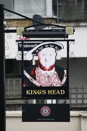 London, UK - June 14, 2012: English pub sign. Public house, known as pub, for drinking and socializing, is the focal point of the community. Pub business, now about 53,500 pubs in the UK, has been declining every year.